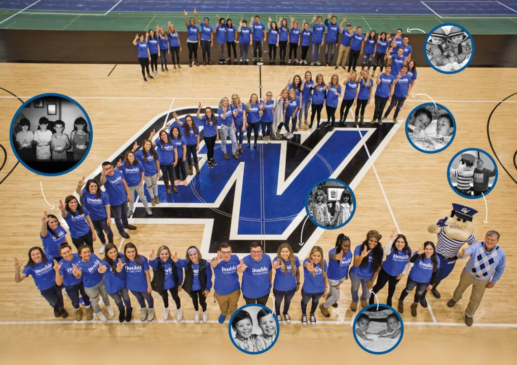Grand Valley twins gather in the fieldhouse and form a number '2' Overlayed are black and white photo insets of 5 sets of twins, one set of quadruplets and Louie and President Haas.